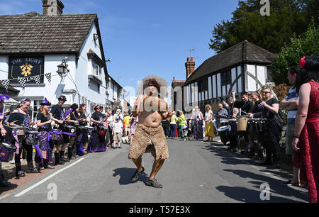 Bolney Sussex, UK. 22nd Apr, 2019. Competitorsenjoy a dance before taking part in the annual Bolney Pram Race in hot sunny weather . The annual races start and finish at the Eight Bells Pub in the village every Easter Bank Holiday Monday Credit: Simon Dack/Alamy Live News - Stock Image