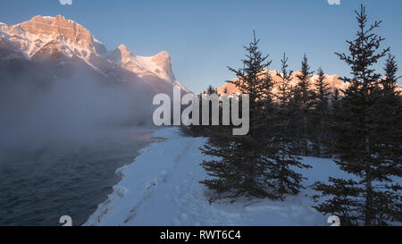 Ha Ling Peak sunrise with Bow River in winter, Canmore, Alberta, Canada, Canadian Rockies - Stock Image