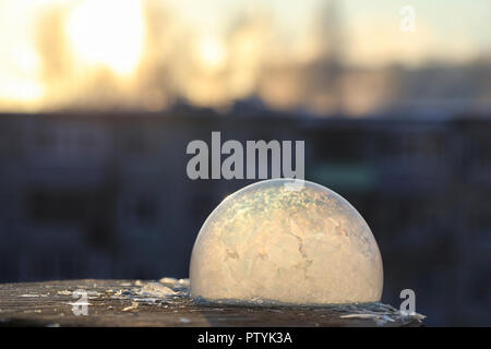 Soap bubbles freeze in the cold. Winter soapy water freezes in air. - Stock Image
