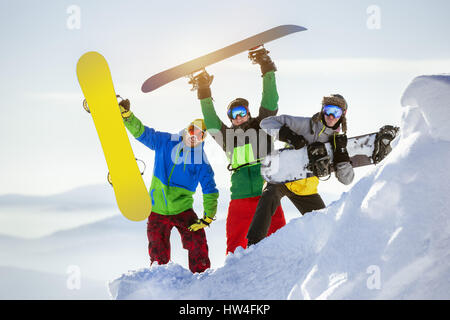Group three happy snowboarders fun - Stock Image