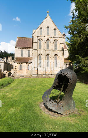 and The east facade of Brinkburn Priory church, with the Brinkburn Bell in the foreground, Longframlington, Northumberland, England, UK - Stock Image