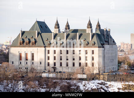 Canada's Supreme Court building: The view from Parliament across a river inlet river to the Supreme Court symbolically separated from the legislature. - Stock Image