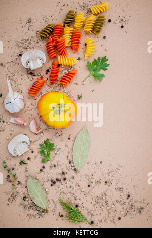 Italian food concept pasta with vegetables and spices herb rosemary ,thyme,parsley,garlic,tomato and champignon - Stock Image