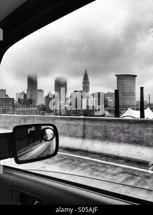 Cleveland, Ohio skyline from the car window on the west shoreway. - Stock Image
