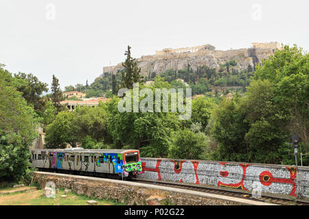 Athens Metro line in front of the Acropolis - Stock Image