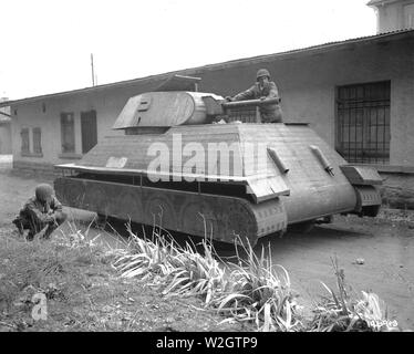 Two GIs Examine a Dummy German Tank, Made of Wood Built on Top of a German 4-Ton Truck. Molsheim Area, France ca. 11/27/1944 - Stock Image