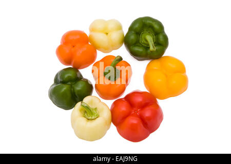 Paprika pieces in five different colors isolated on white background - Stock Image
