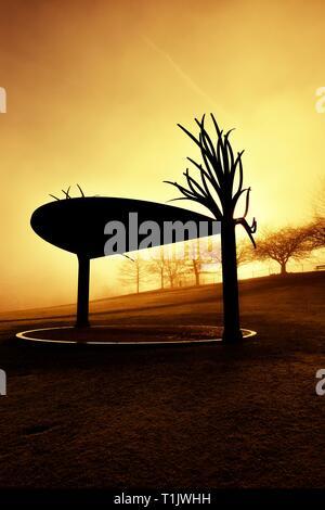 A misty morning sunrise,Glebe park,Bowness on Windermere,Lake District,Cumbria,England,UK - Stock Image