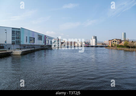 View looking up the River Lagan in Belfast Northern Ireland, with the ICC Waterfront Hall on the left. - Stock Image