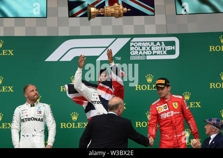 Silverstone, UK. 14th July 2019. FIA F1 Grand Prix of Britain, Race Day; Mercedes AMG Petronas Motorsport, Lewis Hamilton wins the British GP followed by team mate Valtteri Bottas and Scuderia Ferrari, Charles Leclerc Credit: Action Plus Sports Images/Alamy Live News - Stock Image