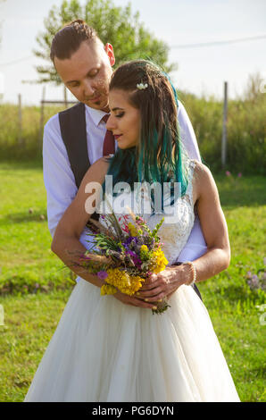 Happy bride and groom after wedding ceremony - Stock Image