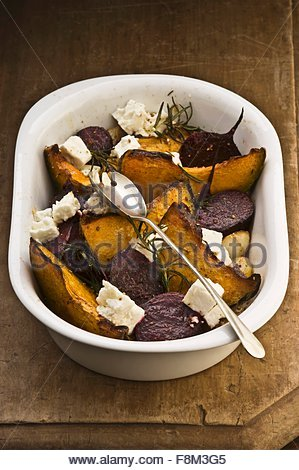 Roasted vegetables with feta and rosemary - Stock Image
