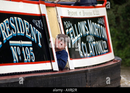 Steam powered narrowboat President on the canal, historic Fellows, Morton & Clayton Ltd. No. 195 - Stock Image