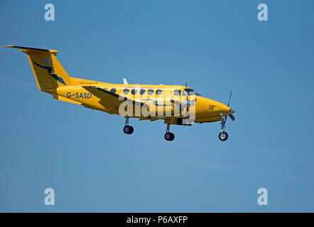 Scottish Air Ambulance approaching Inverness airport on an emergency flight down from the Orkney Islands. - Stock Image
