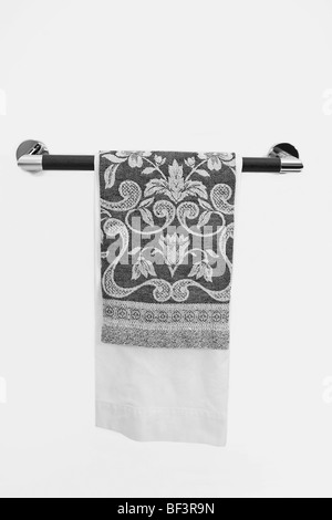 Towel in a towel rail - Stock Image