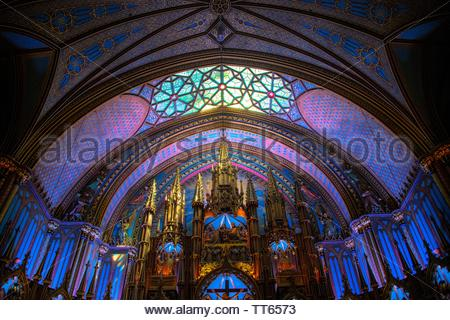 Montreal, Quebec, Canada-May 25, 2019: Stained glass inside of the Notre-Dame Basilica Church in the old district of the city. The area is a Unesco Wo - Stock Image