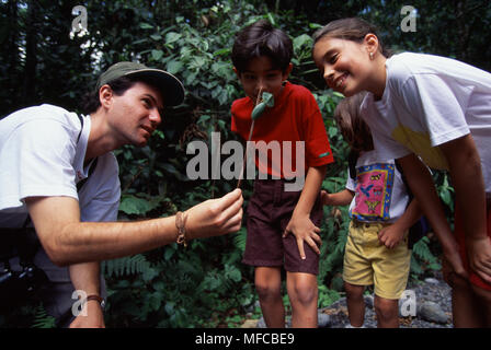 NATURALIST & FAMILY    1998 studying rainforest vegetation (Model release available)  Braulio Carrillo National Park, Costa Rica, Central America - Stock Image