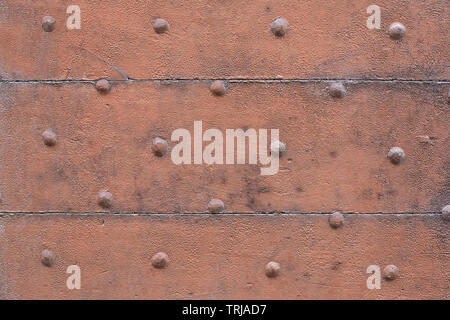 Old wooden, brown painted, door with nails texture background - Stock Image