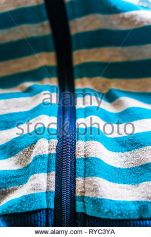 Close up of a striped sweater with zipper and stripes. - Stock Image