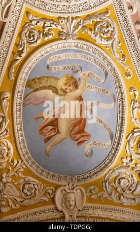 OSSUCCIO, ITALY - MAY 8, 2015: The baroque fresco of angel with the mariological inscriptions in church Sacro Monte della Beata Vergine del Soccorso. - Stock Image