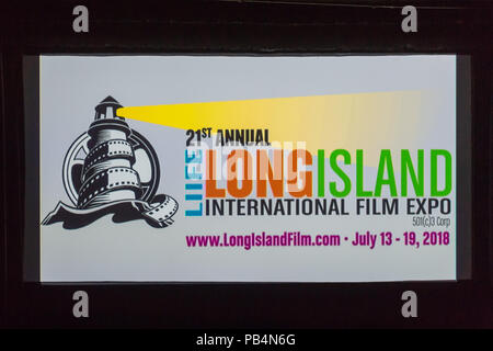 Bellmore, New York, USA. July 18, 2018. At start of final block of film screenings for the 21st Annual LIIFE Long Island International Film Expo, the LIIFE lighthouse and film reel logo and information fill the screen at the Bellmore Movies, the LIIFE location. LIIFE is a nonprofit 501(c)3 Corporation. - Stock Image