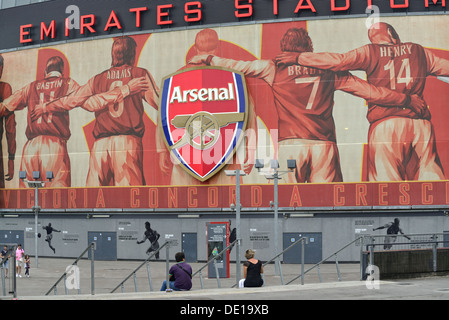 Arsenal stadium with its main heroes on display on the side of the stadium. - Stock Image