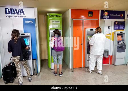 Cartagena Colombia Aeropuerto Internacional Rafael Nunez Airport inside concourse terminal self-service ATM automatic teller machine BBVA Itau Serviba - Stock Image