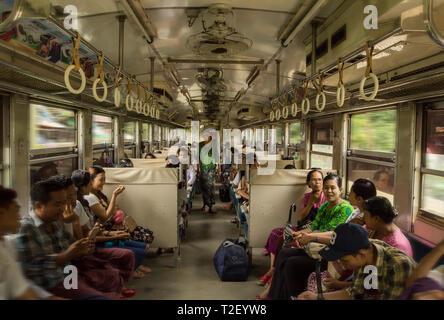 Commuters on the Yangon Circle train, in Yangon, Myanmar. - Stock Image