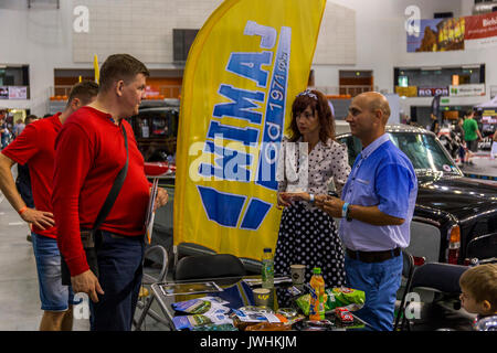 Bielsko-Biala, Poland. 12th Aug, 2017. International automotive trade fairs - MotoShow Bielsko-Biala. People talking. Credit: Lukasz Obermann/Alamy Live News - Stock Image