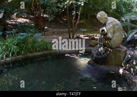 Nymph´s Sculpture and stream. La Concepción botanical garden. Málaga, Andalusia, Spain. - Stock Image