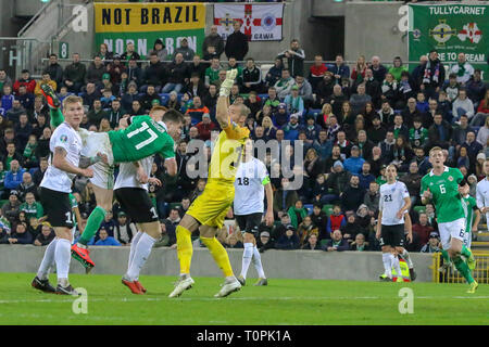 National Football Stadium at Windsor Park, Belfast, Northern Ireland. 21 March 2019. UEFA EURO 2020 Qualifier- Northern Ireland v Estonia. Action from tonight's game. Northern Ireland's Paddy McNair goes close with a header in the second-half. Credit: David Hunter/Alamy Live News. - Stock Image