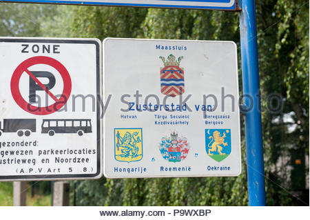 Maassluis The Netherlands  Town entry sign sister cities, Hatvan, Targu Secuiesc Kezdivasarhely, Beregszasz Bergovo - Stock Image
