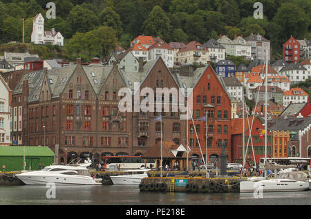 Bergen, Norway - 9 August 2018: General view of Bryggen (The Hanseatic Wharf) in the city of Bergen. The UNESCO World heritage site stems its roots from the Viking Age and it today home to many of the citoes restaurants, pubs, craft shops and museums. The city was for many years the centre of trade between Norway and the rest of Europe and is now usually the starting point to  expeditions into the country. Photo: David Mbiyu Credit: david mbiyu/Alamy Live News - Stock Image
