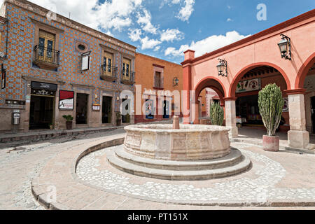 The Bernal public fountain at Zaragoza and Hidalgo streets in the beautiful colonial village of Bernal, Queretaro, Mexico. Bernal is a quaint colonial town known for the Pena de Bernal, a giant monolith which dominates the tiny village is the third highest on the planet. - Stock Image