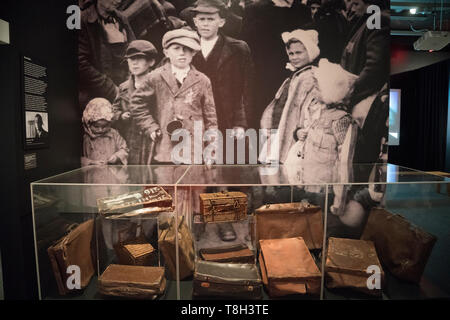 """A display in the exhibition, """"Auschwitz. Not long ago. Not far away"""" shows some of the suitcases that 1.3 million people brought to Auschwitz. - Stock Image"""