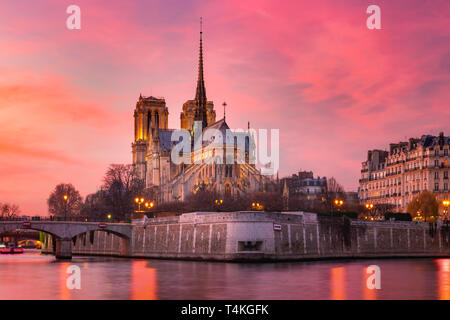 Cathedral of Notre Dame de Paris at sunset, France - Stock Image