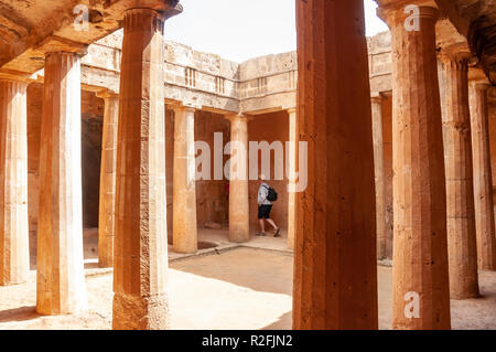 Carved rock tomb with Doric columns in The Tombs of the Kings, Tombs of the Kings Avenue, Paphos (Pafos), Pafos District, Republic of Cyprus - Stock Image