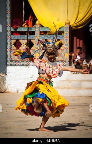 Traditional Buddhist Mask Dance at the Black-necked Crane Festival, Gangte Monastery, Phobjikha Valley, Bhutan - Stock Image
