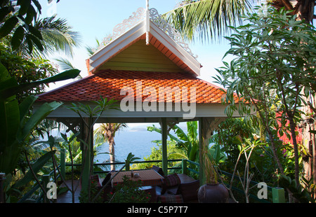 Tropical Garden with Seaview and refuge relax area table and - Stock Image