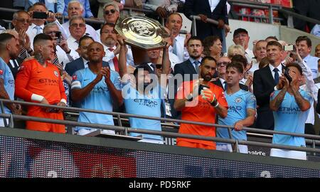 Sergio Aguero of Manchester City holds the trophy aloft during the FA Community Shield match between Chelsea and Manchester City at Wembley Stadium in London. 05 Aug 2018 - Stock Image