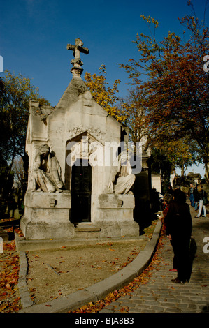 Paris, France - People Visiting Urban Park, Pere Lachaise Cemetery, French Monuments - Stock Image
