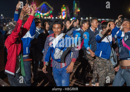 Taunggyi, Myanmar. 12 November 2016.   Youths celebrating successful balloon launch.  A large basket of fireworks - Stock Image