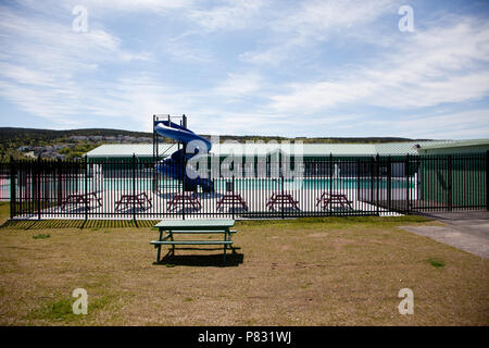 June 23, 2018- St. Johns, Newfoundland: The new pool splash area at Bowring Park, surrounded by safety fence on a summer day - Stock Image