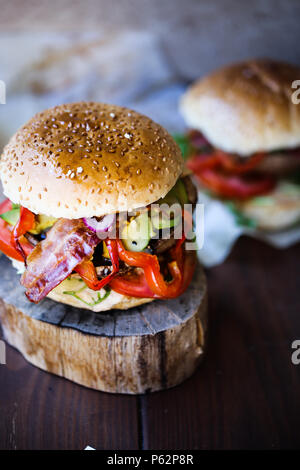 Delicious grilled portobello mushroom burger with a lot of veggies - Stock Image