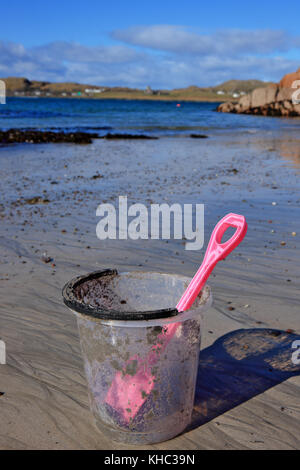 Bucket and spade on a sandy beach in Scotland - Stock Image