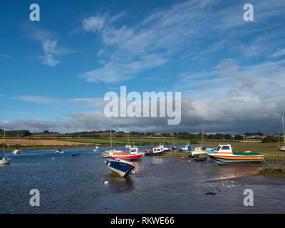 View of Alnmouth with boats on the tidal Aln Estuary. - Stock Image