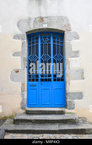 Bright blue and ornate metal door on an old stone building in Quimper, Brittany, France. - Stock Image