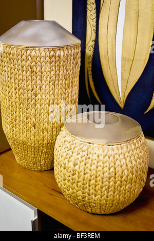 Close-up of decorative urns on a table - Stock Image