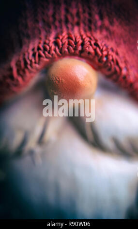 Detail of the face of a Father Christmas ornament - Stock Image