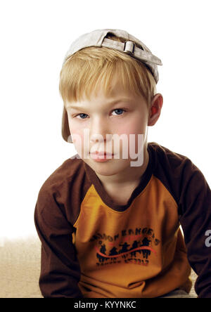 Blond boy with cap, casual look - Stock Image